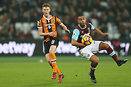 Sam Clucas of Hull City sees his shot blocked by Winston Reid of West Ham United. Premier league match, West Ham Utd v Hull city at the London Stadium, Queen Elizabeth Olympic Park in London on Saturday 17th December 2016.<br /> pic by John Patrick Fletcher, Andrew Orchard sports photography.