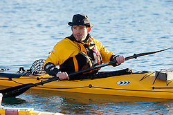 Richard Harpham. Scottish Sun sports editor Iain King takes part in a practise session for his charity kayak challenge, in the waters of the harbour at St Abbs..Pic © Michael Schofield...