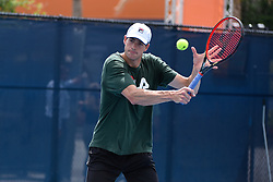 March 25, 2019 - Miami Gardens, FL, U.S. - MIAMI GARDENS, FL - MARCH 25:  John Isner from the from the United States warms up on the practice court before his match at the Miami Open on March 25, 2019 at Hard Rock Stadium in Miami Gardens, FL(Photo by Michele Sandberg/Icon Sportswire) (Credit Image: © Michele Sandberg/Icon SMI via ZUMA Press)