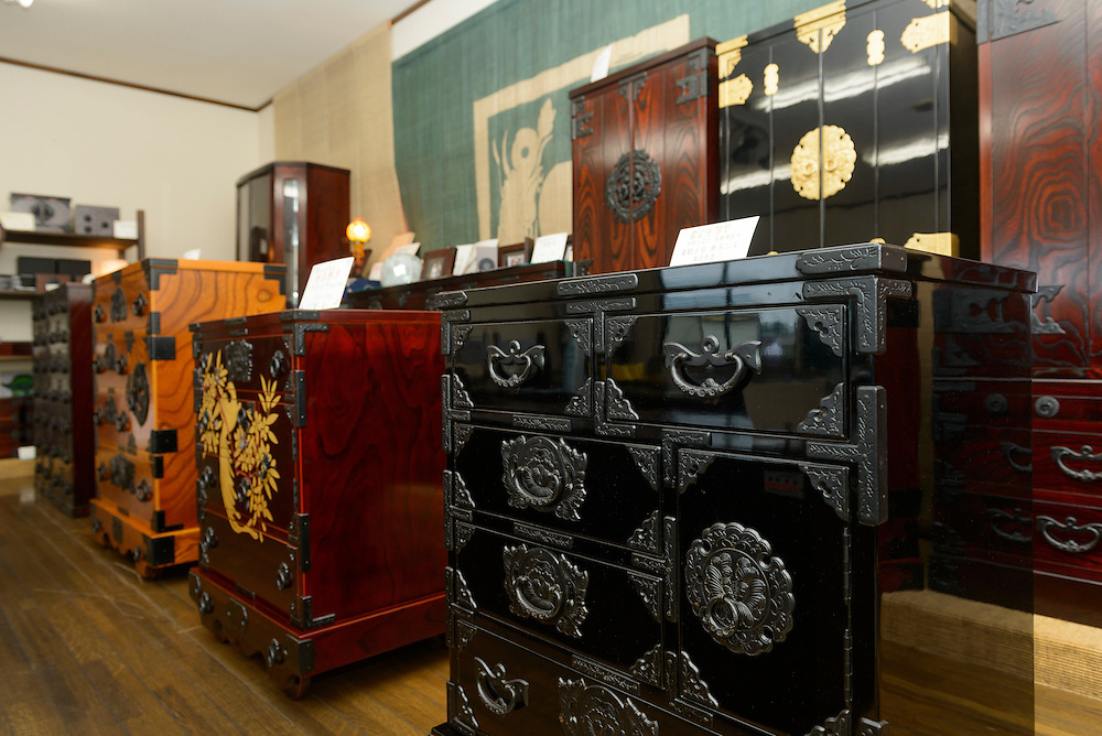 The showroom of Iwayado Tansu Seisakujo, Oshu City, Iwate Prefecture, Japan, July 18, 2013. Iwayado Tansu chests of drawers have been made in the city of Oshu since the 1780s. They are noted for their fine lacquer finish and finely-wrought metalwork fittings.