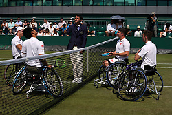 The coin toss as Alfie Hewett and Gordon Reid play on day eleven of the Wimbledon Championships at the All England Lawn Tennis and Croquet Club, Wimbledon. PRESS ASSOCIATION Photo. Picture date: Friday July 13, 2018. See PA story TENNIS Wimbledon. Photo credit should read: John Walton/PA Wire. RESTRICTIONS: Editorial use only. No commercial use without prior written consent of the AELTC. Still image use only - no moving images to emulate broadcast. No superimposing or removal of sponsor/ad logos. Call +44 (0)1158 447447 for further information.