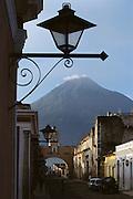 Santa Catarina Arch in Antigua, Guatemala, with volcano in distance.