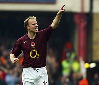 Photo: Chris Ratcliffe.<br />Arsenal v West Bromwich Albion. The Barclays Premiership. 15/04/2006.<br />Dennis Bergkamp of Arsenal celebrates his goal by pointing to his family on 'Dennis Bergkamp Day' at Highbury
