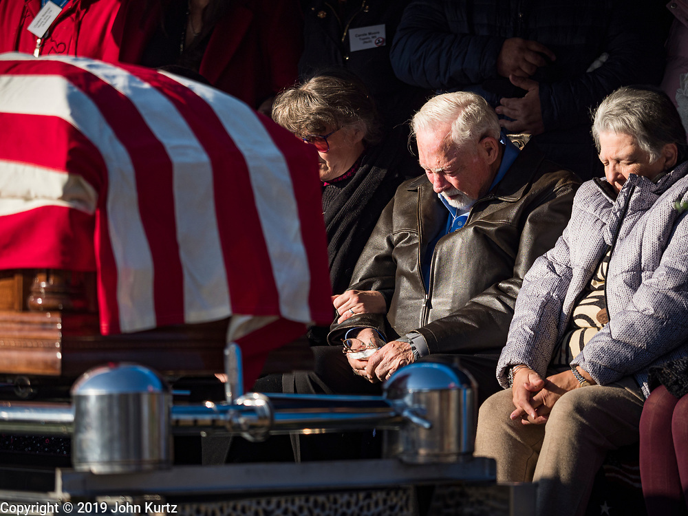 22 NOVEMBER 2019 - DES MOINES, IOWA: Family members of US Marine Corps Reserve Private Channing Whitaker bow their heads during Whitaker's reinterment service in Glendale Cemetery. Whitaker died in the Battle of Tarawa on Nov. 22, 1943. He was buried on Betio Island, in the Gilbert Islands, and his remains were recovered in March 2019. He was identified by a DNA match with surviving family members in Iowa. Whitaker was reintered in the Glendale Cemetery in Des Moines exactly 76 years after his death in World War Two. About 1,000 US Marines and sailers were killed in four days during the Battle of Tarawa.            PHOTO BY JACK KURTZ