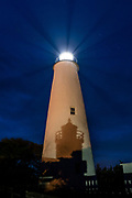 A headlamp projects a shadow of the donations box onto the Ocracoke Lighthouse on Ocarcoke Island, NC on May 15, 2018.