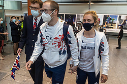 Licensed to London News Pictures. 09/08/202. London, UK. Dream team cyclists, Jason and Laura Kenny arrive at London Heathrow Terminal 5 from Tokyo this afternoon as Team GB celebrate 22 gold medals in one of the most successful Olympics on record. Jason and Laura Kenny became Britain's most successful Olympic athletes with Jason clinching his 7th gold and Laura winning her 5th gold including a gold and silver at the Tokyo games. Photo credit: Alex Lentati/LNP