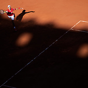 PARIS, FRANCE June 13.   Novak Djokovic of Serbia in action against Stefanos Tsitsipas of Greece as the early evening shadows creep across Court Philippe-Chatrier during the final of the singles competition at the 2021 French Open Tennis Tournament at Roland Garros on June 13th 2021 in Paris, France. (Photo by Tim Clayton/Corbis via Getty Images)