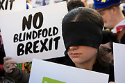 People's Vote supporters wearing blindfolds and carrying placards assembled in Parliament Square for the Blindfold Brexit protest ahead of a crunch debate in the House of Commons to illustrate that this Brexit would provide no clarity and no closure about our future relationship with Europe on 14th February 2019 in London, England, United Kingdom.
