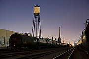 "Old Water tower in train yards in Vernon illuminated by moonlight. Located just a few miles from downtown Los Angeles, Vernon's official slogan is ""Exclusively Industrial"" and at the last census had a population of 91. Los Angeles, California, USA"