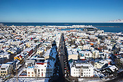Aerial view of the capital city of Reykjavik showing brightly coloured houses and rooftops, Iceland