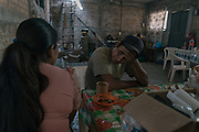 FEBRUARY 5: Santos has breakfast along her wife Justina at their home in Ayahualtempa, Guerrero state, Mexico. Their sons Alex (13) and Marvin (10) have been training along him and the community police to defend their town from drug cartel Los ardillos.