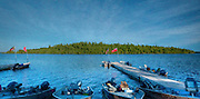 Calm night approaches as fishermen take their evening meal at the lodge. A digital watercolor on Fine Art Paper.