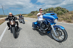 The Ness family, Arlen, Cory and Zach, rides together south of Flagler Beach on A1A during the Daytona Bike Week 75th Anniversary event. FL, USA. Monday March 7, 2016.  Photography ©2016 Michael Lichter.