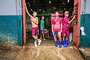 09 JUNE 2014 - YANGON, MYANMAR: Workers in the San Pya Fish Market (also spelled Sanpya). San Pya Fish Market in Yangon is one of the largest wholesale fish markets in Yangon. The market is busiest in early in the morning, from before dawn until about 10AM.    PHOTO BY JACK KURTZ