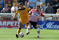Exeter City's Aaron Davies is tackled by Newport County's Andy Sandell - Photo mandatory by-line: Harry Trump/JMP - Mobile: 07966 386802 - 06/04/15 - SPORT - FOOTBALL - Sky Bet League Two - Exeter City v Newport County - St James Park, Exeter, England.