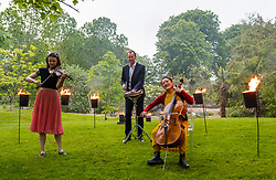 EMBARGOED UNTIL 10AM, WEDNESDAY 2 JUNE<br /> Edinburgh International Festival, Edinburgh, Scotland, United Kingdom: <br /> Pictured: Jenna Reid on fiddle, Iain Sandbanks, percussionist and Su-a Lee, cellist, in the Royal Botanic Garden.<br /> Edinburgh International Festival pioneers the return of live performance in Scotland from 7–29 August with a diverse programme of UK and international artists. This year's programme features over 170 classical and contemporary music, theatre, opera, dance and spoken word performances, including 15 new commissions and premieres. Audience safety is key with measures including outdoor venues, social distancing, shorter performances without intervals, audience members in bubbles and, for the first time, online access to free performances.   <br /> Sally Anderson | EdinburghElitemedia.co.uk