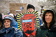 DENVER, CO - APRIL 29: Joe McGregor, 66, of Denver, Colorado holds a resist sign at the People's Climate March on Denver in Denver, Co. on April 29, 2017. The protest which focused on climate change coincided with newly elected President Donald Trump's 100th day in office.(Photo by Marc Piscotty/ © 2017)