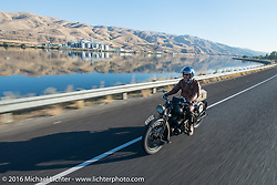 Paul D'Orleans riding Bryan Bossier's 1933 Brough Superior 11-50 along the Snake River leaving Lewiston during Stage 15 (244 miles) of the Motorcycle Cannonball Cross-Country Endurance Run, which on this day ran from Lewiston, Idaho to Yakima, WA, USA. Saturday, September 20, 2014.  Photography ©2014 Michael Lichter.