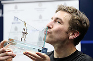 Mathieu Castagnet of France kisses the Canary Wharf Classic Trophy after winning the final.. the Final, Omar Mosaad of Egypt v Mathieu Castagnet of France , Canary Wharf Squash Classic 2016 , at the East Wintergarden in Canary Wharf , London on Friday 11th March 2016.<br /> pic by John Patrick Fletcher, Andrew Orchard sports photography.