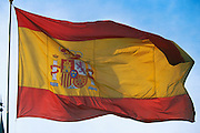 SPAIN, MADRID The Spanish national flag displaying the Spanish coat-of-arms