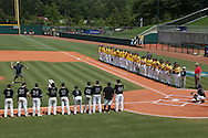 04 June 2016: Nova Southeastern Director of Athletics Michael Mominey throws a ceremonial first pitch to Jake Anchia (right). The Nova Southeastern University Sharks played the Millersville University Marauders in Game 14 of the 2016 NCAA Division II College World Series  at Coleman Field at the USA Baseball National Training Complex in Cary, North Carolina. Nova Southeastern won the game 8-6 and clinched the NCAA Division II Baseball Championship.