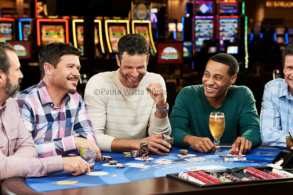 Group of male friends at casino table games in Califonia