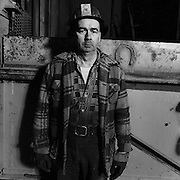 Deckman in front of the Macassa Mine No. 3 Shaft, Kirkland Lake, Ontario. From the book Cage Call: Life and Death in the Hard Rock Mining Belt. An in-depth project spanning over 12-years examining communities in one of the richest mining regions in the world located in Northwestern Ontario and Northeastern Quebec in Canada.