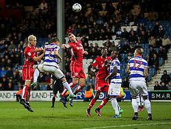 Aden Flint of Bristol City can't quite direct a header towards goal as Ariel Borysiuk of Queens Park Rangers challenges - Rogan Thomson/JMP - 18/10/2016 - FOOTBALL - Loftus Road Stadium - London, England - Queens Park Rangers v Bristol City - Sky Bet EFL Championship.