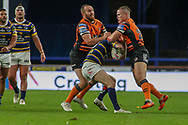 Daniel Smith and Tyla Hepi of Castleford tackle Leed Richie Myler  during the Betfred Super League match between Leeds Rhinos and Castleford Tigers at Emerald Headingley Stadium, Leeds, United Kingdom on 26 October 2020.