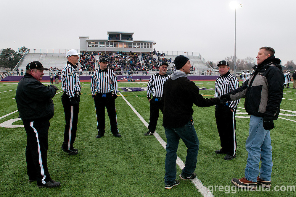 Vale athletic Director Tom Snook (far right) and game officials (L to R: Todd Gorham, Rob Harnack, Doug Henderson, Neal Cooper) before the Vale - Santiam Christian 3A Championship game at Kennison Field, Hermiston, Oregon, Saturday, November 28, 2015. Vale won 27-20.
