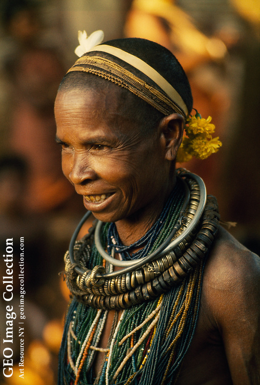 A Bonda tribeswoman dons aluminum jewelry and a traditional haircut.