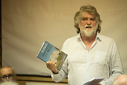 A day of books in Portobello as part of the three-day long Portobello Book Festival. A series of packed events to hear a number of authors, some local, others from further afield talk about their writing. Pictured: Sean Bradley discusses the works of polymath and urban planner Patrick Geddes.<br /> <br /> <br /> © Jon Davey/ EEm
