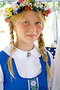 Teenager wearing garland and costume of Sweden. Svenskarnas Dag Swedish Heritage Day Minnehaha Park Minneapolis Minnesota USA