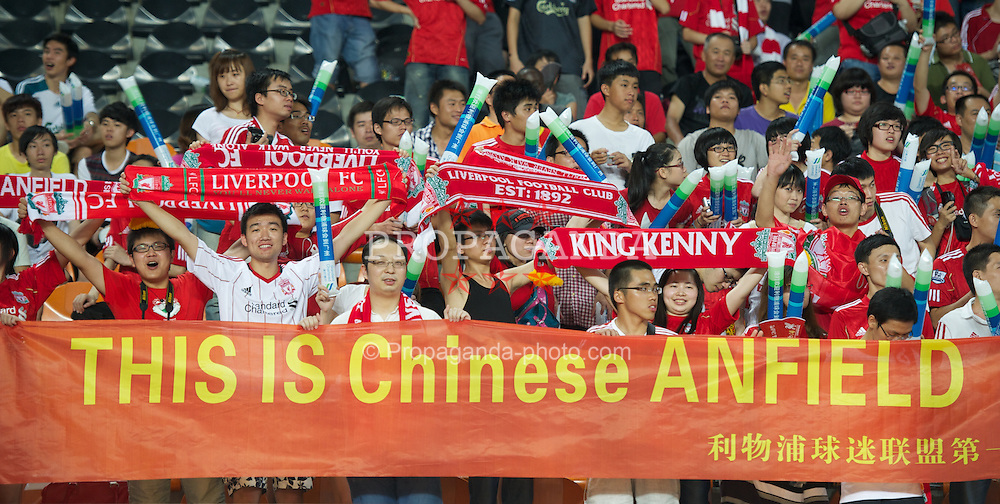 GUANGZHOU, CHINA - Wednesday, July 13, 2011: Liverpool's Chinese supporters during the first pre-season friendly match against Guangdong Sunray Cave on day three of the club's Asia Tour at the Tianhe Stadium. (Photo by David Rawcliffe/Propaganda)