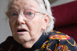 Woman with Alzheimer's disease looking concerned,