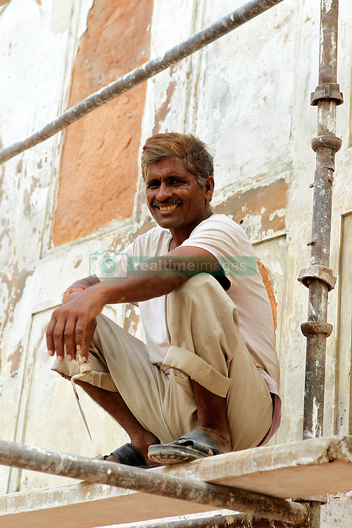 A builder takes a rest in The Red Fort in Delhi India.  The Commonwealth Games are being held in Delhi India between the 3rd and 14th October 2010..Photoby:  Ron Gaunt/SPORTZPICS