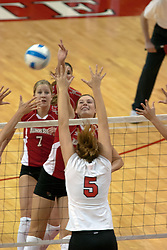 09 OCT 2005 Redbird Emily Kabbes takes some pleasure in hitting this ball past the Braves Katrina Goncher. The Illinois State University Redbirds hosted arch rival Bradley University Braves.  The Redbirds soared over the Braves, taking the match in 4 games, losing only game number 2.  Action included play by Braves Star Lindsey Stalzer who is ranked no. 7 in the nation in kills per game.  The first defeat of the conference season for the Braves took place at Redbird Arena on Illinois State's campus in Normal IL.