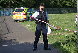 © Licensed to London News Pictures. 11/06/2018. London, UK. Police close off a play area in Northolt after a 20 year old was stabbed last night.  Another youth was stabbed in nearby Harrow. Police said a male was arrested near the scene of the stabbing in Northolt.Photo credit: Peter Macdiarmid/LNP