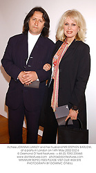 Actress JOANNA LUMLEY and her husband MR STEPHEN BARLOW, at a party in London on 14th May 2002.OZZ 6