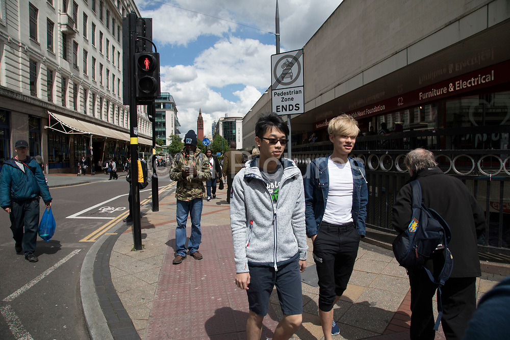 Multicultural scene in the shopping district on Corporation Street in Birmingham, United Kingdom.