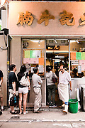 Waiting in line for beef brisket soup, Central, Hong Kong.