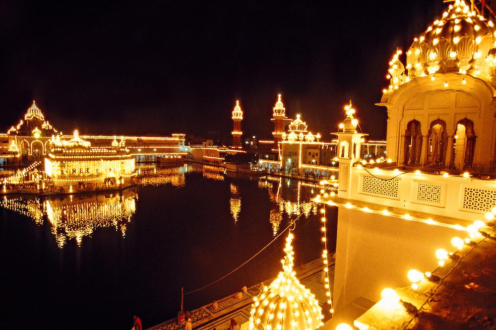 The Golden Temple (holiest Sikh shrine) illuminated at night, Amritsar, Punjab, India