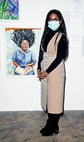 Naveena at the Tate Liverpool exhibition of Liverpool NHS worker portraits by Aliza Nisenbaum  the exhibition celebrates Merseyside NHS workers=