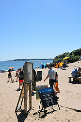 Social distancing sign during Covid pandemic, South beach, Tenby, Pembrokeshire, South Wales July 2021