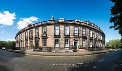 View of townhouses on historic Carlton Terrace  below Calton Hill in Edinburgh, Scotland, United Kingdom