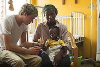Niall Horan from one direction visits Araba (2) who's suffering from pneumonia and mum Leticia (24) in a Paediatric ward Princess Mary Louise Hospital, Accra, Ghana