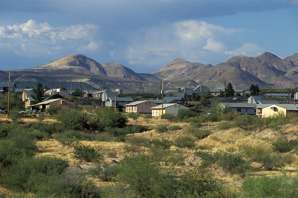 A group of family homes in Peridot on the San Carlos Apache Indian Reservation in Arizona, USA. June 2004.