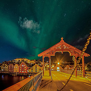 Beautiful northern light (nordlys in Norwegian) over the iconic Gamlebybro (city bridge) and the beautiful wooden houses of Bakklandet in Trondheim. Please feel free to find me by: |Website| ,|Facebook| , |Instagram| ,|Google+|