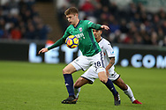 Kyle Naughton  of Swansea city challenges Sam Field of West Bromwich Albion (28).  Premier league match, Swansea city v West Bromwich Albion at the Liberty Stadium in Swansea, South Wales on Saturday 9th December 2017.<br /> pic by  Andrew Orchard, Andrew Orchard sports photography.