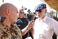 11 AUG 2003, KABUL/AFGANISTAN:<br /> Peter Struck, SPD, Bundesverteidigungsminister, gibt einem Soldaten des Bundeswehr-Radiosenders Radio Andernach ein kurzes Statement, waehrend seinem Besuch des deutschen Kontingents der International Security Assistance Force, ISAF, Camp Warehouse, Lager der ISAF Truppen in der Naehe von Kabul<br /> IMAGE: 20030811-01-083<br /> KEYWORDS: Bundeswehr, Streitkraefte, Streitkräfte,   Bundeswehr,